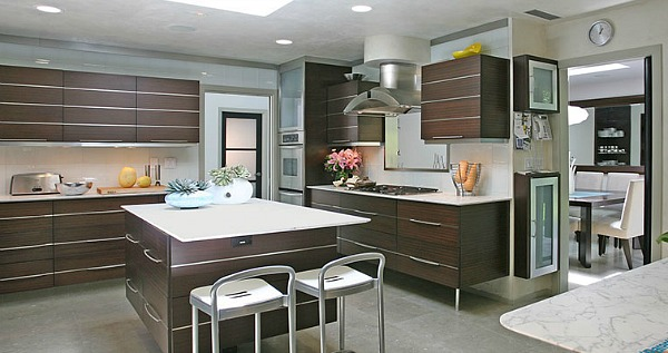brown cabinets with white backsplash