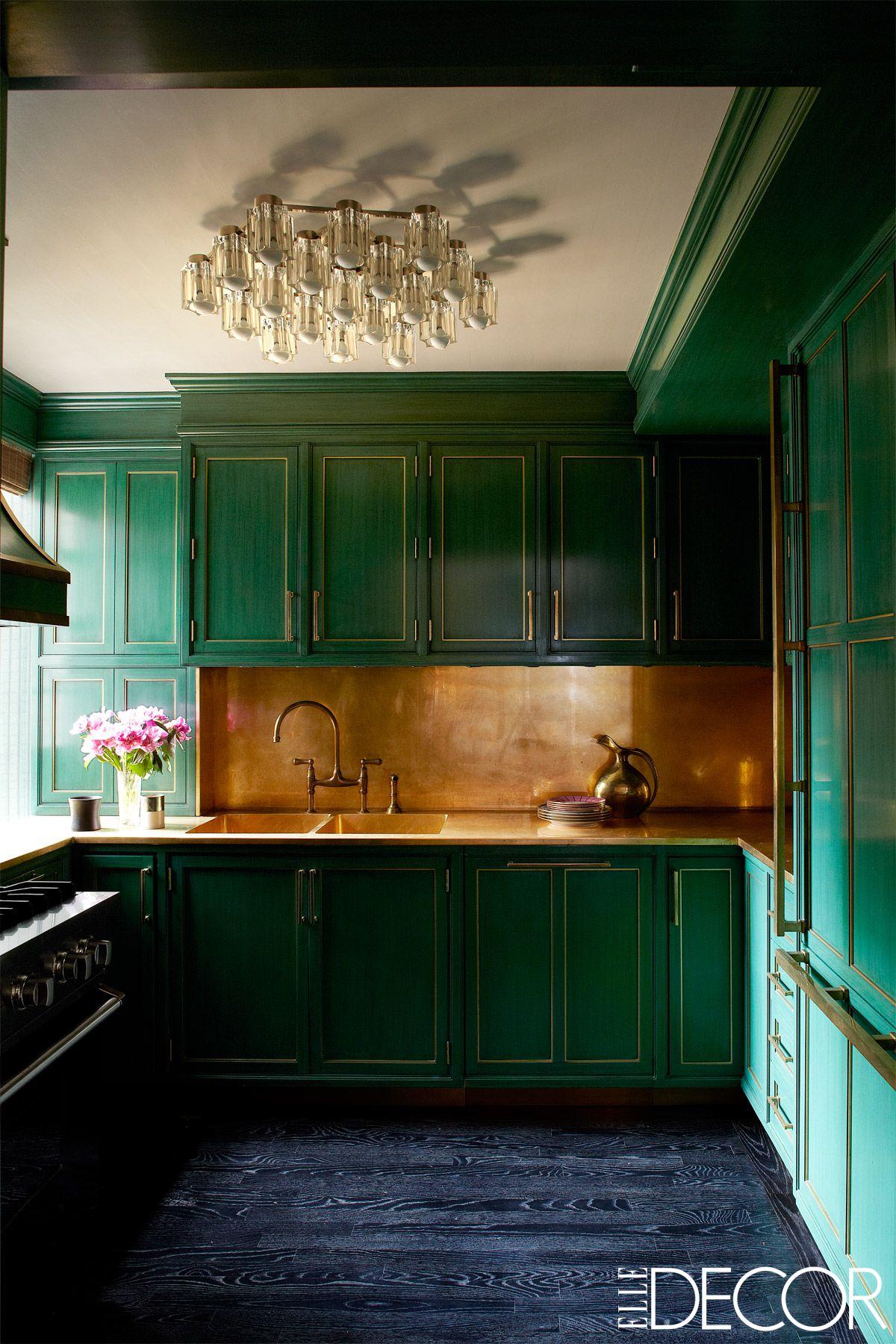 emerald green kitchen with cooper backsplash